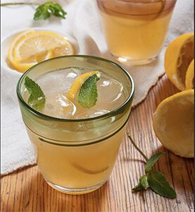 Photo of Iced tea with lemonade, a slice of lemon and a few leaves of mint