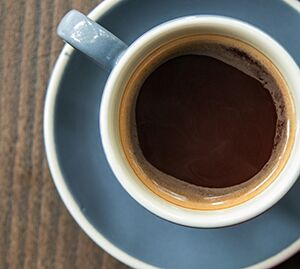 Top down photo of drip coffee in a cup on a saucer