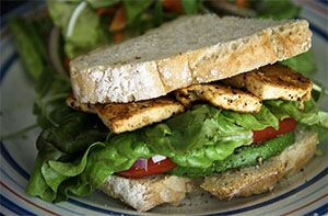 Photo of a grilled tofu sandwich with lettuce and tomato
