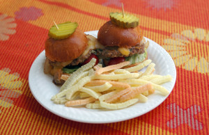 Photo of meatless sliders on a plate with vegetable fries