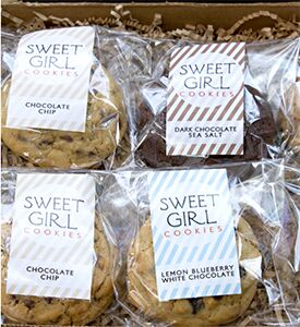 Photo of a several varieties of packaged Sweet Girl cookies